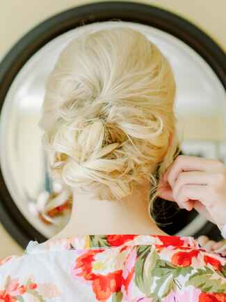Boho wedding hairstyle with a messy low chignon