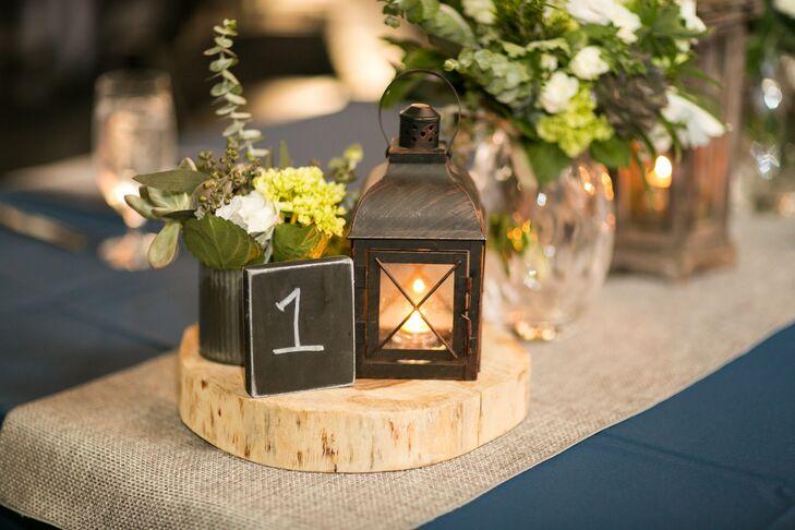 Rustic lantern centerpieces on wooden pedestals