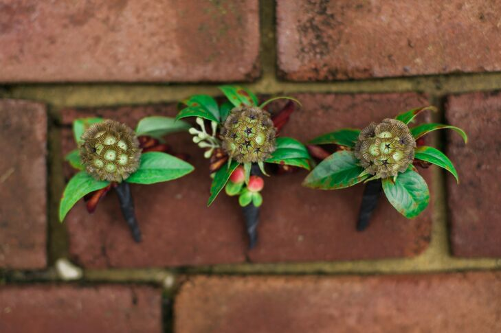 Christine and John wanted boutonnieres for the men that embodied rustic and masculine flair. Growing Wild Floral created the perfect arrangements of scabiosa pods, hypericum berries and eucalyptus.