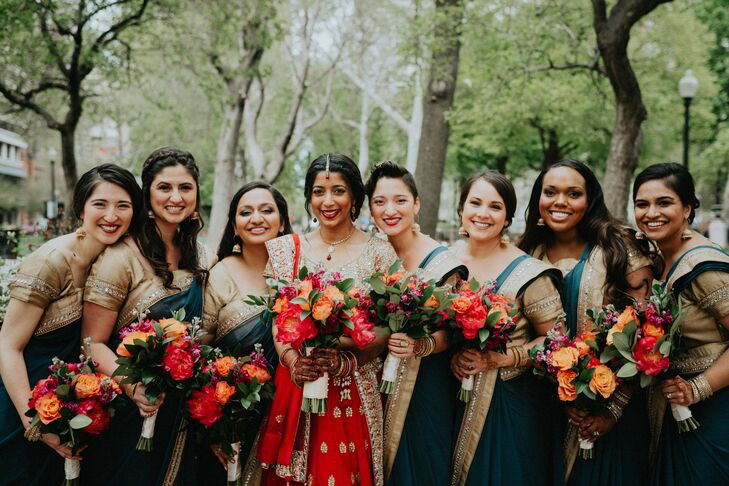 "Anjali's seven bridesmaids wore slate blue and gold saris and matching gold statement earrings for their walk down the aisle. ""I thought the color would complement the other colors in the wedding and continue with the overall look,"" Anjali says. ""The blue theme matched Christophe's ceremony outfit, and the gold borders matched mine."""