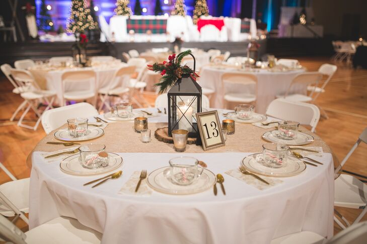 Elizabeth and Mason's dining tables continued their rustic Christmas look and were dressed in white tablecloths with gold table runners and lantern centerpieces.