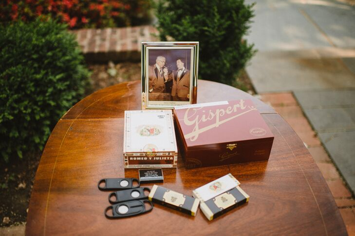 "Mike's father organized a cigar bar with a cigar box and cigars that had been in the family for years, vintage photos of his family members smoking cigars and his  cigar cutter. ""It was a great addition for the guests offering a touch of nostalgia,"" Beth says."