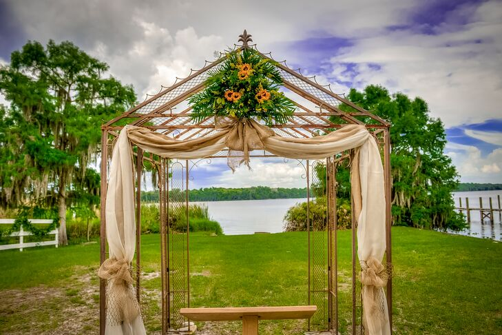 Rustic Wedding Arch with Draping and Sunflowers