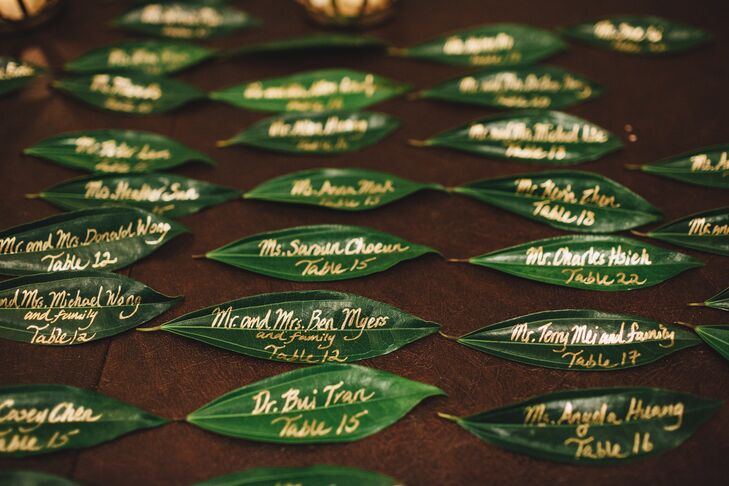 Yan opted to make the escort cards herself, using leaves in lieu of card stock to achieve an earthy, bohemian look. She hand-lettered the names and seating assignments on each leaf in gold ink for a hint of glamour.