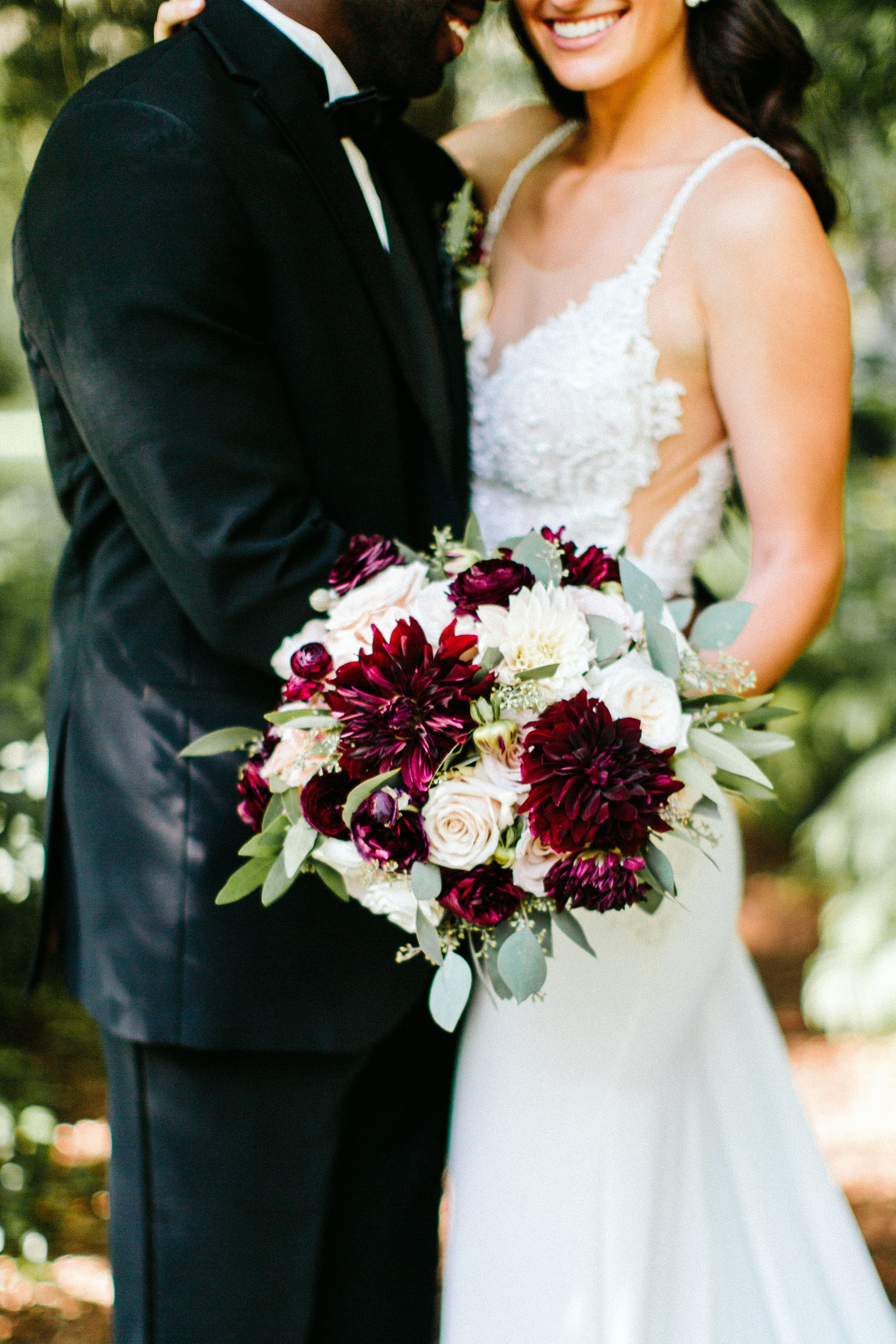 Ivory And Burgundy Bouquet Of Roses Ranunculus And Dahlias