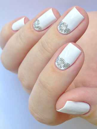 Bridal manicure idea with silver rosette stickers