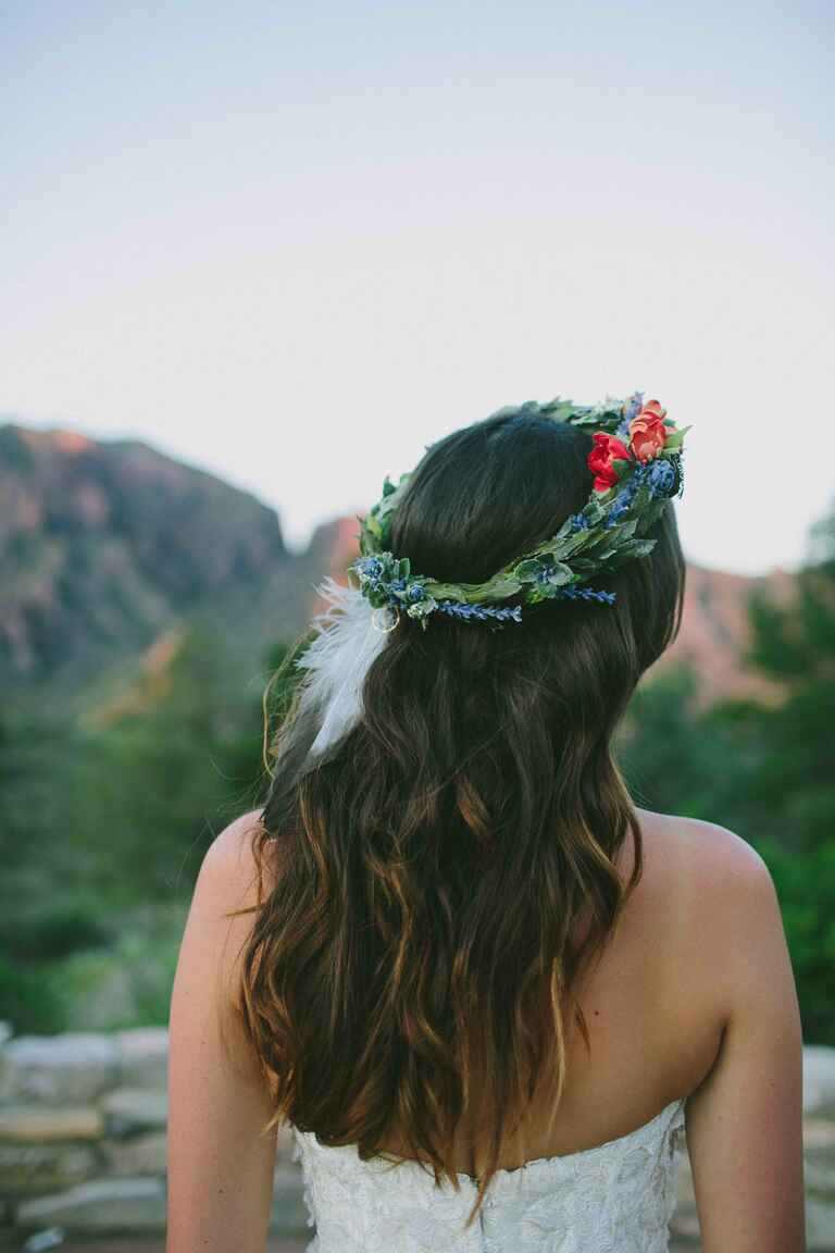 Boho flower crown with a white feather