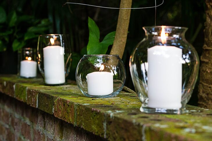 Large White Candles In Clear Glass Vases