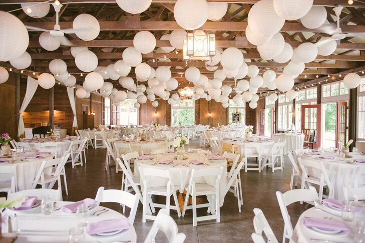 """It felt like a great place for a party,"" Katie says of MillCreek Barns in Watervliet, Michigan. ""We wanted our wedding to be a big, happy family party."""