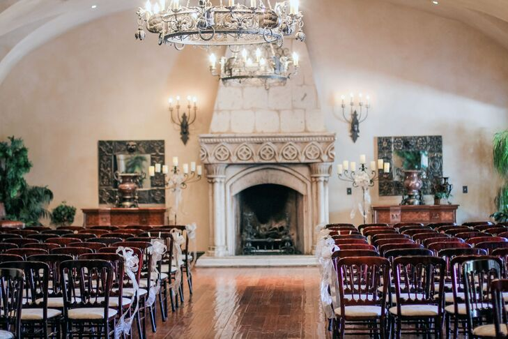 Rebecca and Todd wanted an indoor wedding to escape the summer heat in Arizona. The stone fireplace and chandeliers in Villa Siena in Gilbert, Arizona, allowed them to stay cool and have a beautiful, elegant ceremony.