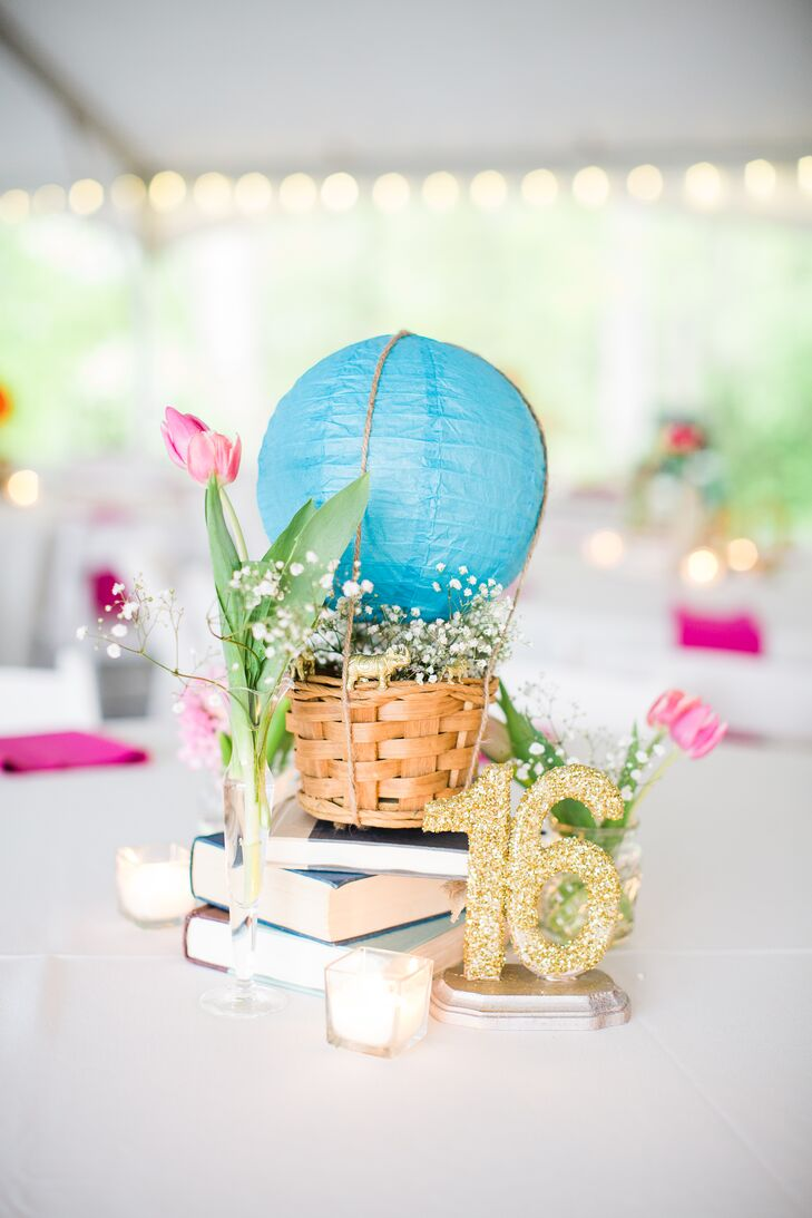 Sophia is obsessed with hot air balloons. With that in mind, the reception tables were decorated with little paper lanterns to look like hot air balloons. The baskets were filled with baby's breath and were displayed on top of a stack of books since Sophia and Jake love to read. Sparkly gold table numbers added plenty of glitz to the the Barn at Valhalla in Chapel Hill, North Carolina.