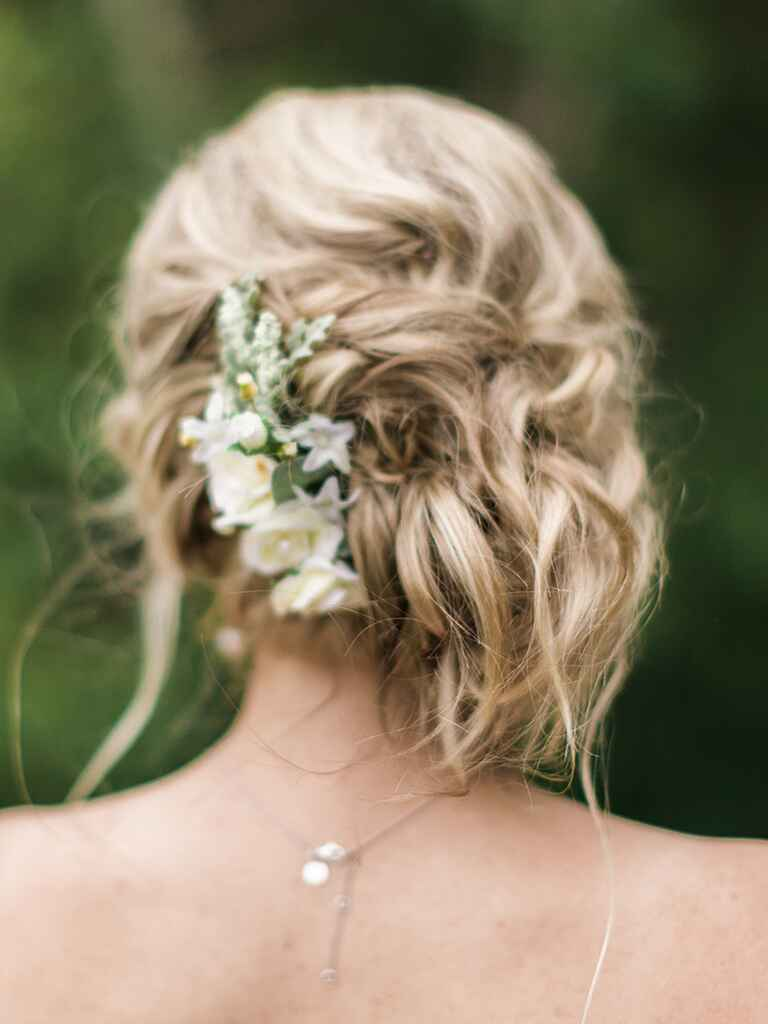 Low messy boho bun wedding hairstyle