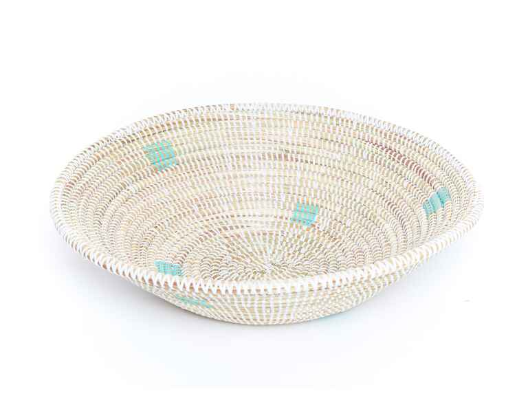 Hand woven bowl with aqua polka dots