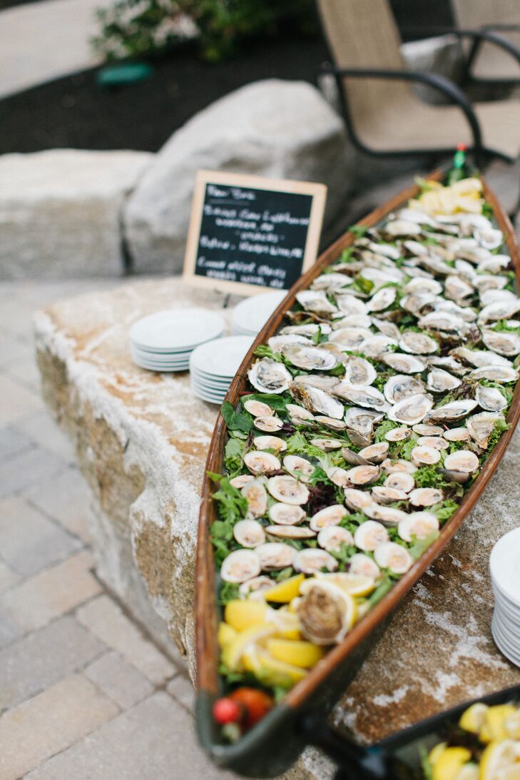 """Greg is a bit of a foodie, so for him, the menu was really one of the key focal points of the wedding,"" says Alissa. ""He insisted that we have a fully stocked raw bar with large shrimp, littleneck clams, and oysters all served out of ice filled boats with all the accoutrements."""