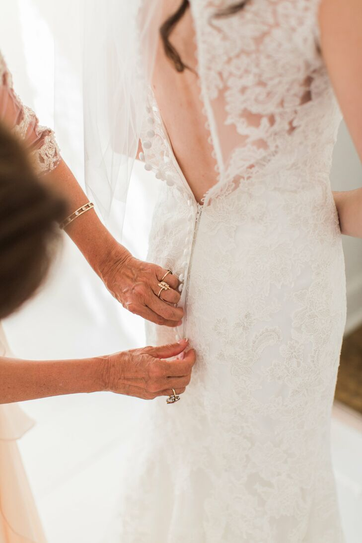 "After spotting a lace Kenneth Winston dress online, Tara tracked down the ivory, fit-and-flare lace gown. ""I knew I didn't want the typical sleeveless dress, so this was perfect,"" she says of the design, which featured satin-covered buttons and a high neckline."