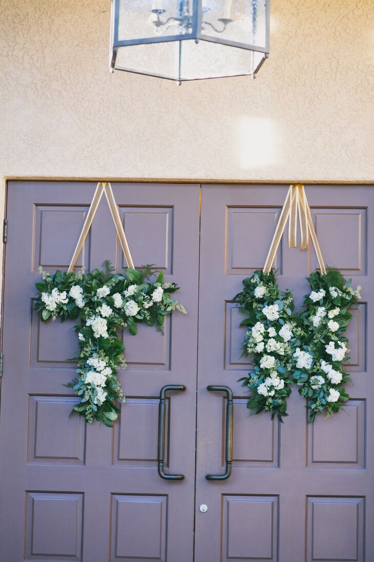 "Elegant Details created lush hanging decorations made of green leaves speckled with ivory blooms. The arrangements spelled out ""T"" for Tyler and ""N"" for Nadia, which added a cute personal touch to the decorations."
