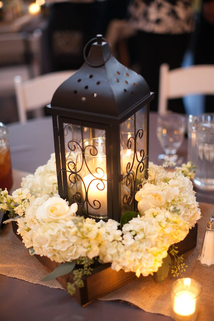"Rachel and Alexey drew a lot of inspiration for the wedding day decor from decorative lanterns and used them throughout, from the ceremony aisle to the reception centerpieces. ""The theme itself was inspired by lanterns,"" Rachel says. ""I saw a lantern used as a centerpiece on Pinterest, and I ended up basing everything off my lantern idea."""
