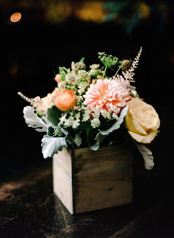 Rustic Peach Centerpieces In Wooden Vases