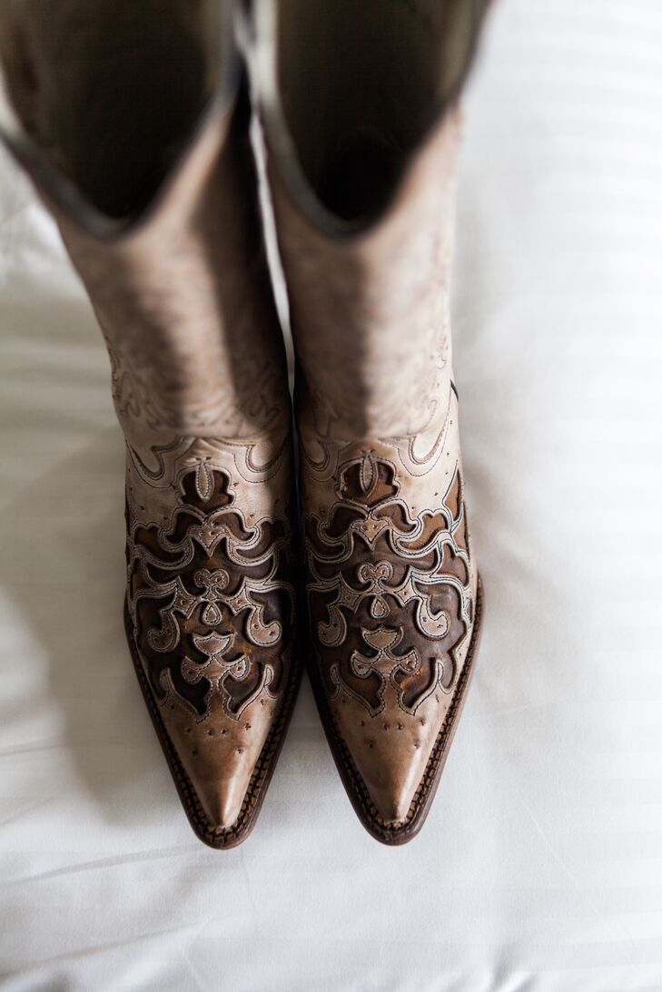 Courtney bought her wedding-day cowboy boots at a Nashville, Tennessee, boutique and had Jason write a message on the soles.