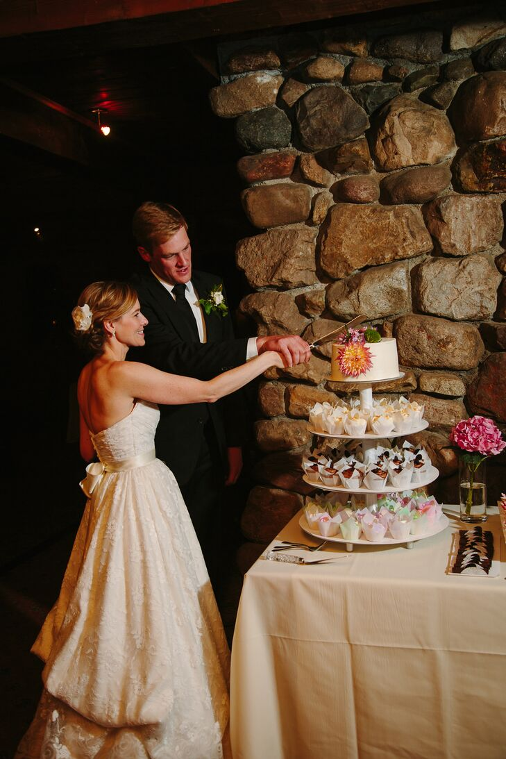 For dessert, Patty and Taylor cut a one-tier white buttercream cake. The confection was displayed on top of a four-tier stand holding cupcakes in different flavors for guests.