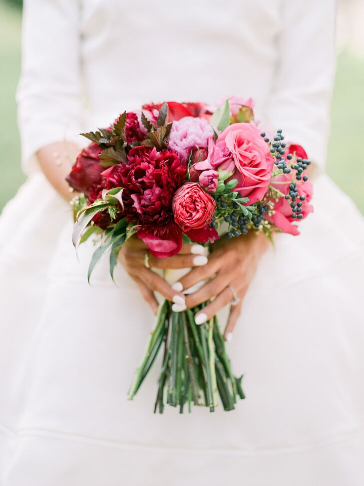 Pigmint of Fayetteville, Arkansas, created Layne's relaxed, colorful bouquet. Its crimson and fuchsia blooms were accented with deep blue blossoms and greens.