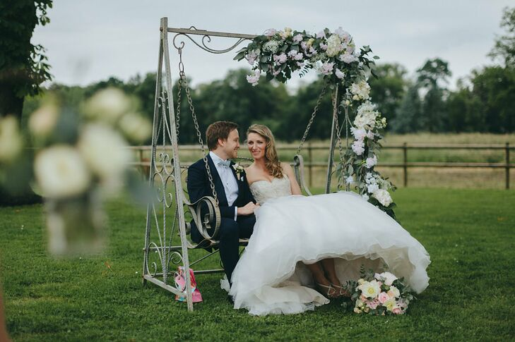 A vintage swing was draped in a garland of blush and ivory florals. Alexandra and Samuel were seated on the swing during the ceremony.