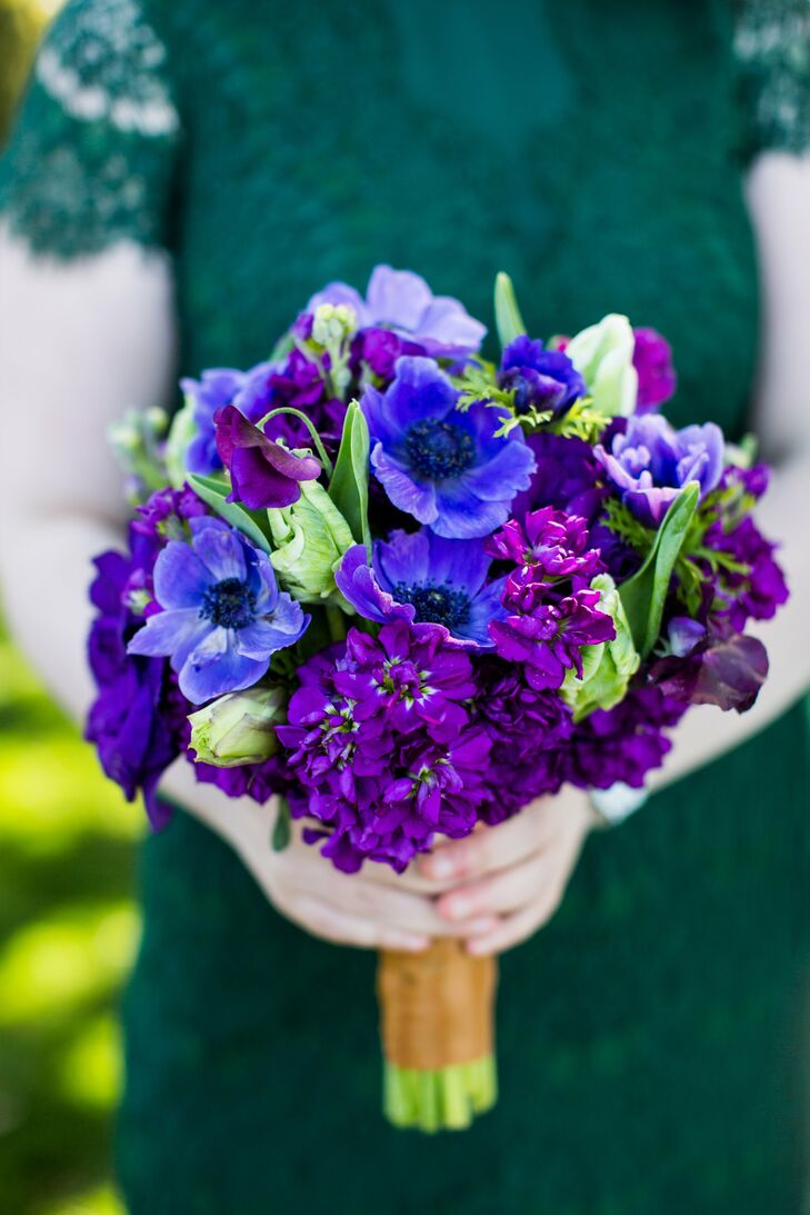 Each bridesmaid carried her own unique bouquet--this one featured a lovely arrangement of stock, anemones, sweet peas and tulips