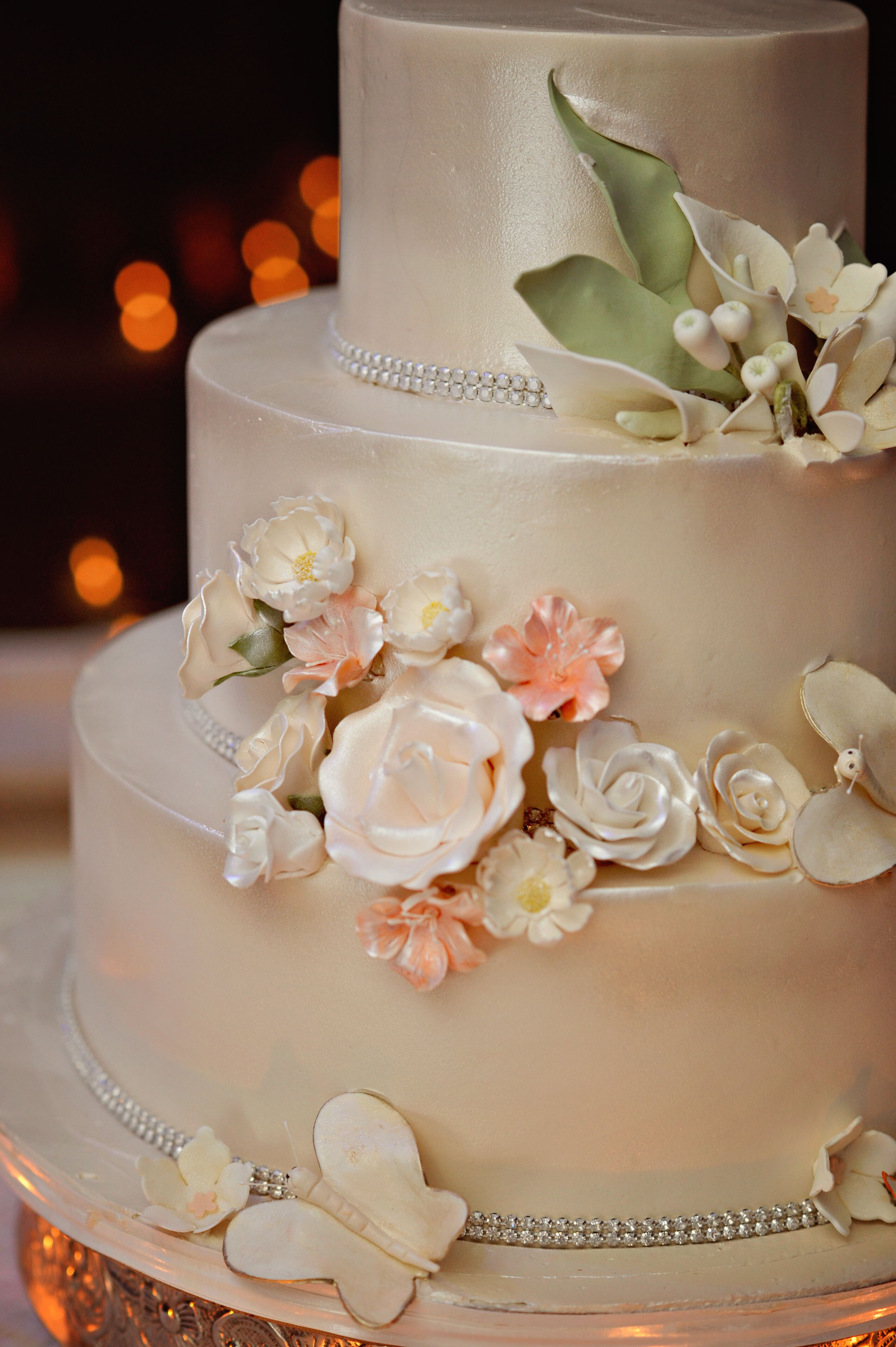 Three Tier Wedding Cake With Champagne Colored Luster Dust