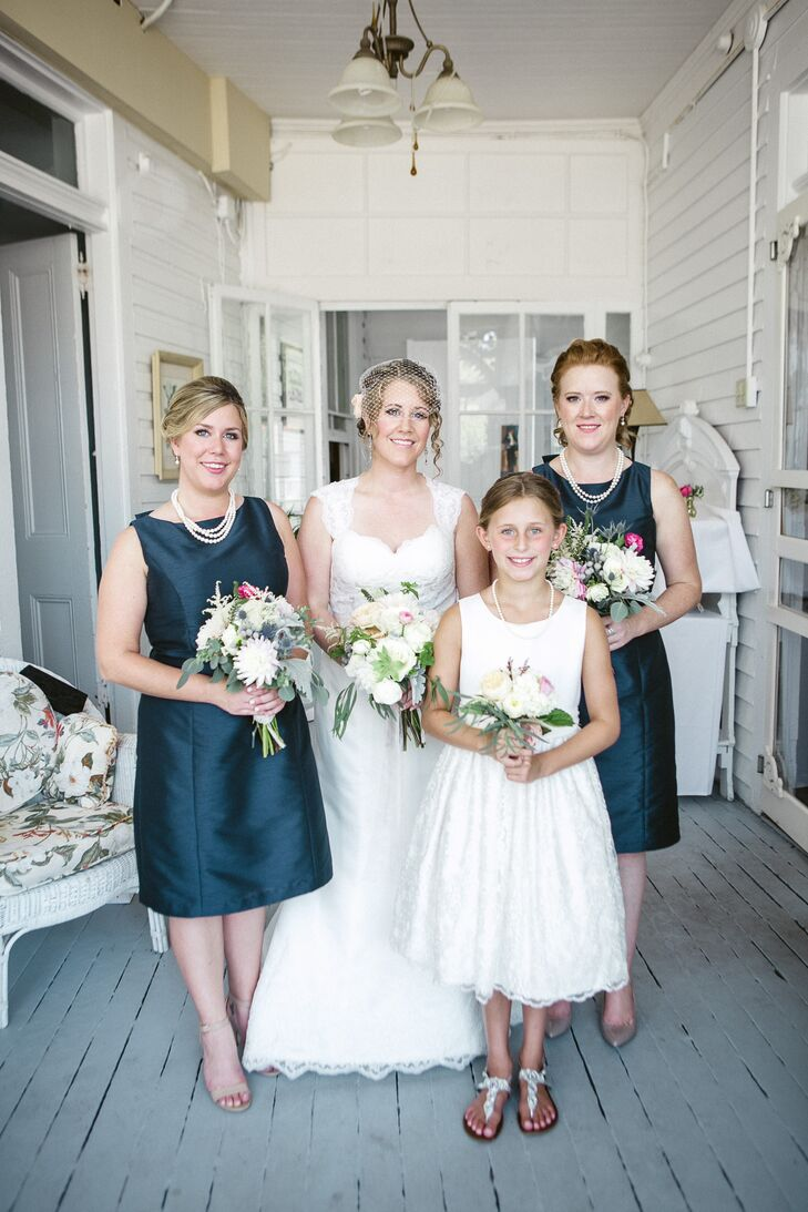 "When it was time to pick her bridesmaids, Catherine turned to two special people: her sisters. ""I told them I wanted something in a rich navy blue, knee length, elegant and traditional looking,"" Catherine says. Both women picked  knee-length navy dresses with a high neckline and finished the look with a string of pearls from the bride."