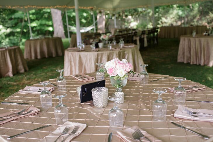 The reception tables were decorated with checkered champagne linens and class centerpieces including white roses and pink peonies. Crystal candle votives added plenty of romance to the tented space.