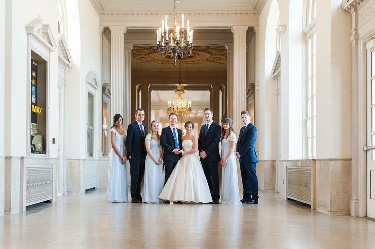 The bridesmaids wore robin-egg blue, floor-length dresses with cap sleeves, while the groomsmen wore navy tuxedos with blue ties.