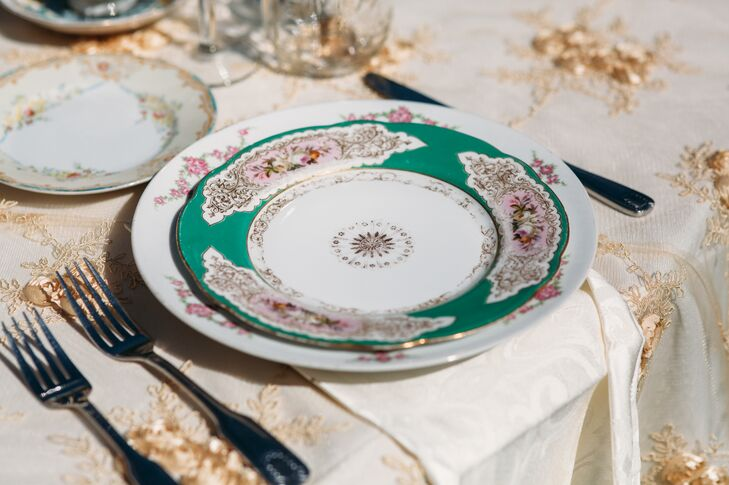 "Antique green and white chinaware set at each seat contributed to the ""shabby-chic tea party"" atmosphere that Monique and Shade had imagined for their wedding day at Rancho San Antonio in Santa Ynez Valley, California."