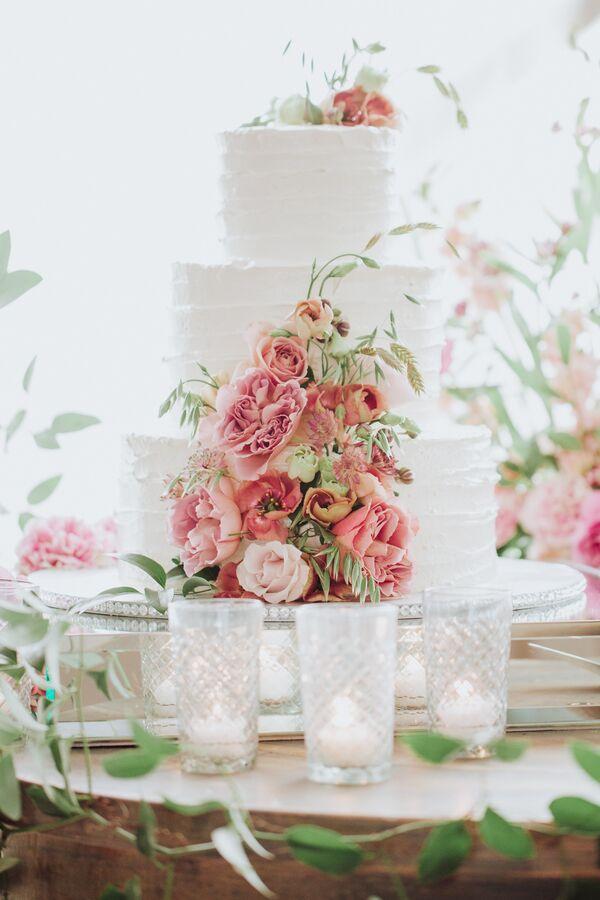 Romantic wedding cakes tiered white wedding cake with romantic pink flowers mightylinksfo