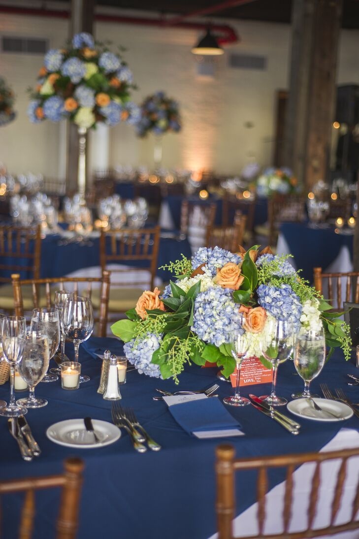 Blue And Orange Centerpiece With Blue Tablecloth