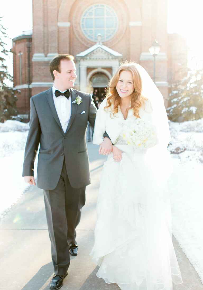 Couple walking out of the ceremony at their winter wedding