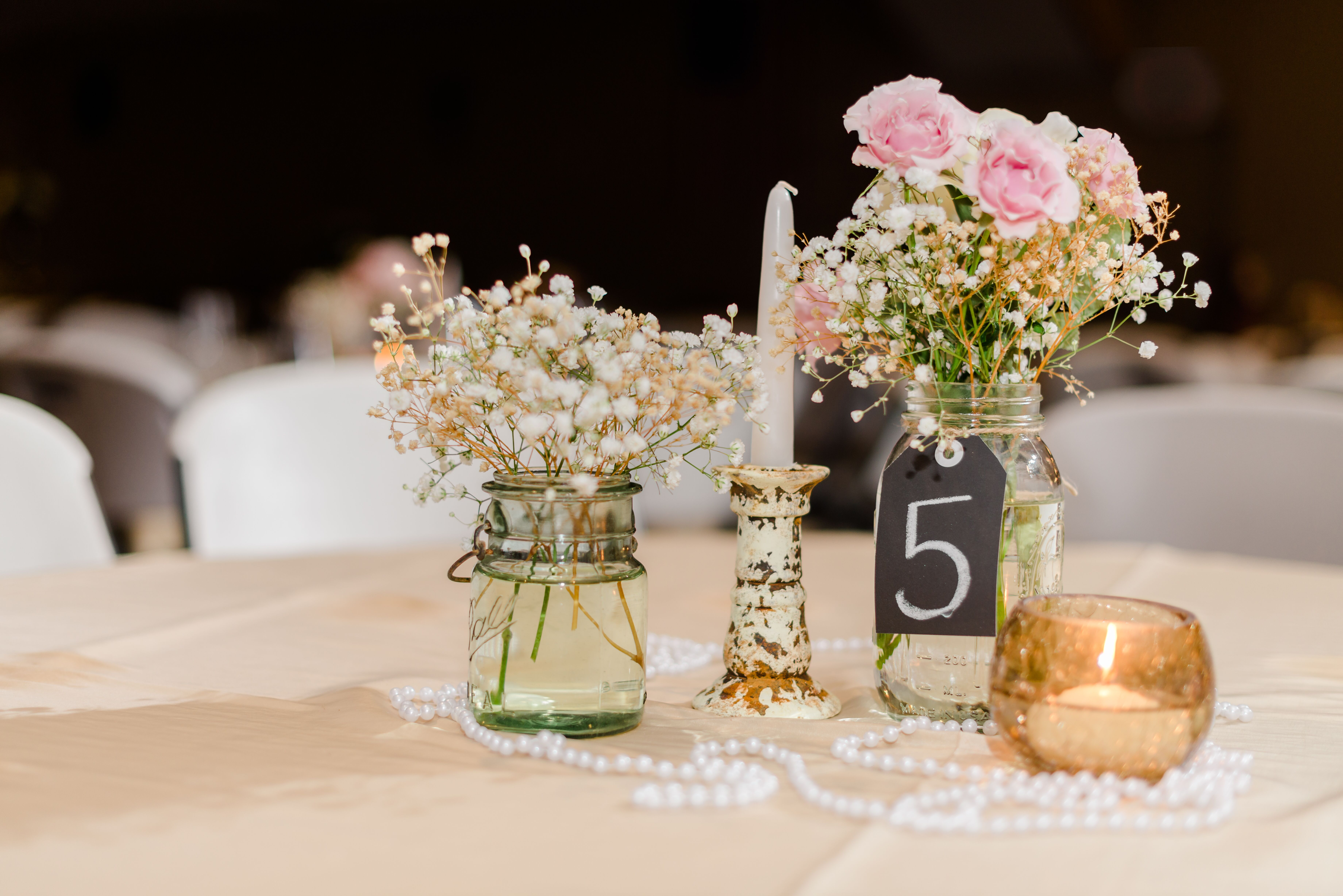 Mason jar and pearl centerpieces