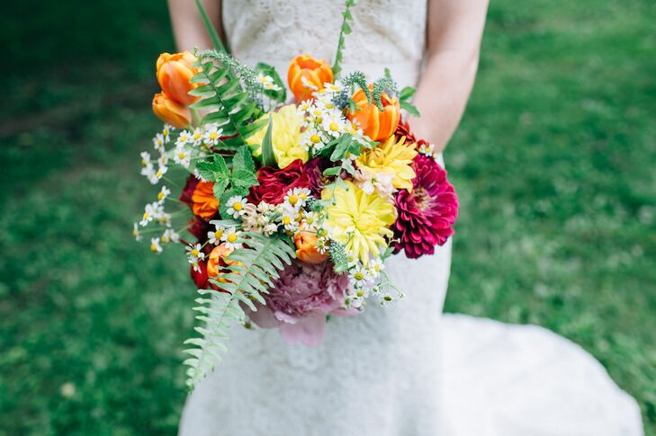 Holly Long of Naturally Elegant Designs re-created the beauty of Vermont's summer scenery in Olivia's bouquet with a palette of bright orange, yellow and red and full blooms that ranged from tulips and dahlias to tiny white wildflowers.