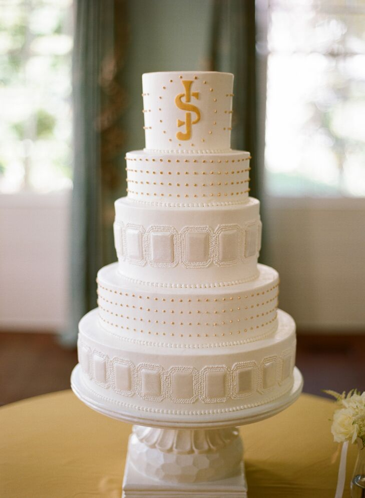 The buttercream cake's rectangle design was inspired by the bride's emerald cut engagement ring and the yellow monogram was used throughout their paper goods.