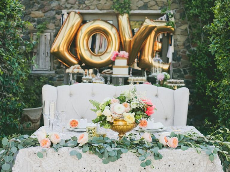 "Oversized ""Love"" gold balloons"