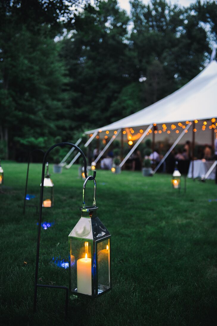 Blue lighting leading to the reception tent was designed to mimic the lighting used on airport runways.