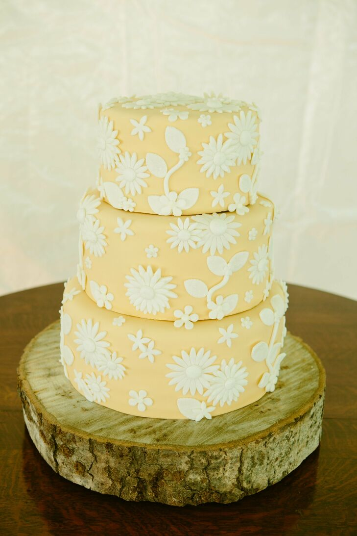 The couple chose a floral fondant cake with three tiers and a yellow color.