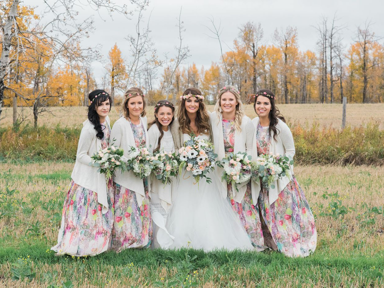 Bride with bridal party floral bridesmaid dresses