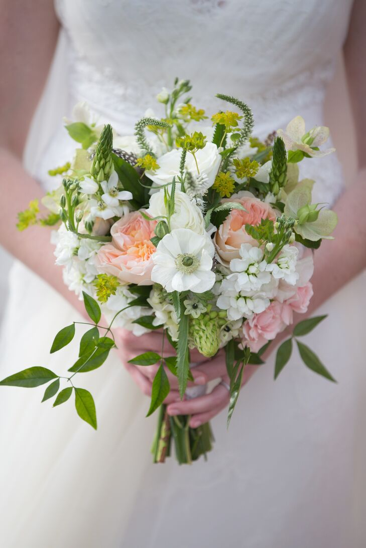 Ashley carried a sweet bouquet full of hydrangeas, ranunculus, anemones and majolica spray roses.