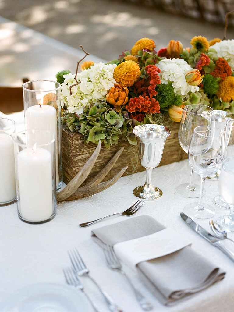 Orange and red rustic wedding tablescape