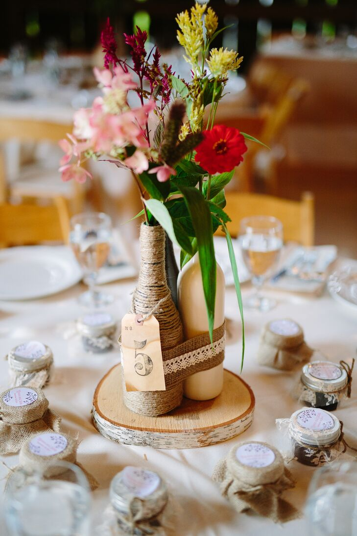 Diy rustic wine bottle centerpiece Wine bottle wedding centerpieces