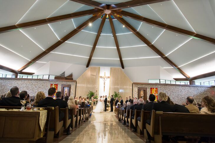 Allie and Liam got married in Kansas, where they were born and raised. Cure of Ars Catholic Church in Leawood, Kansas, was perfect for their vows. Allie grew up in the church, which was super-modern with stained glass in the rounded ceiling.