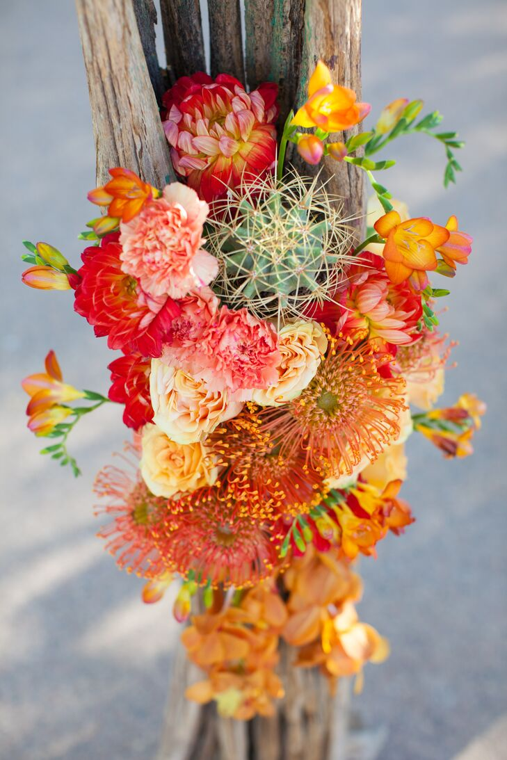 Orange rose dahlia and pincushion flower arrangements izmirmasajfo
