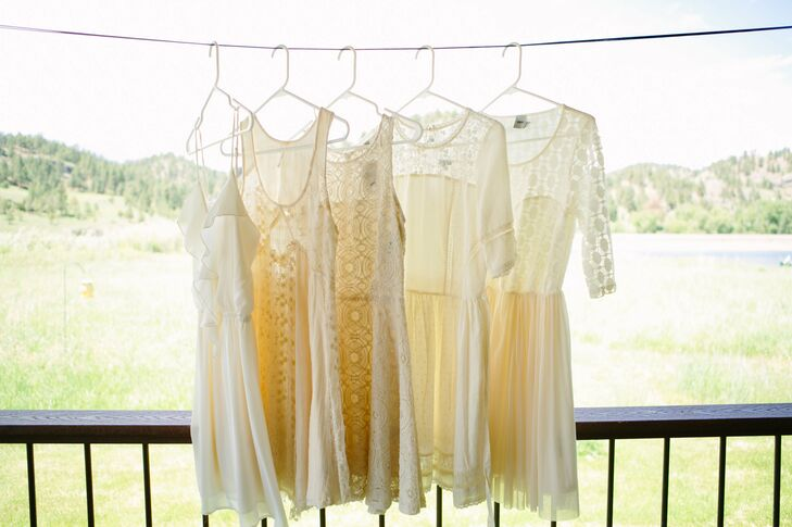 Bridesmaids wore mismatched ivory dresses with elements of lace for the wedding day.