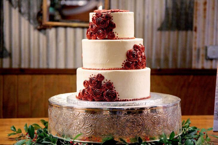 The bride's cake was a three layer white buttercream cake with deep red rosettes that matched the bouquets.