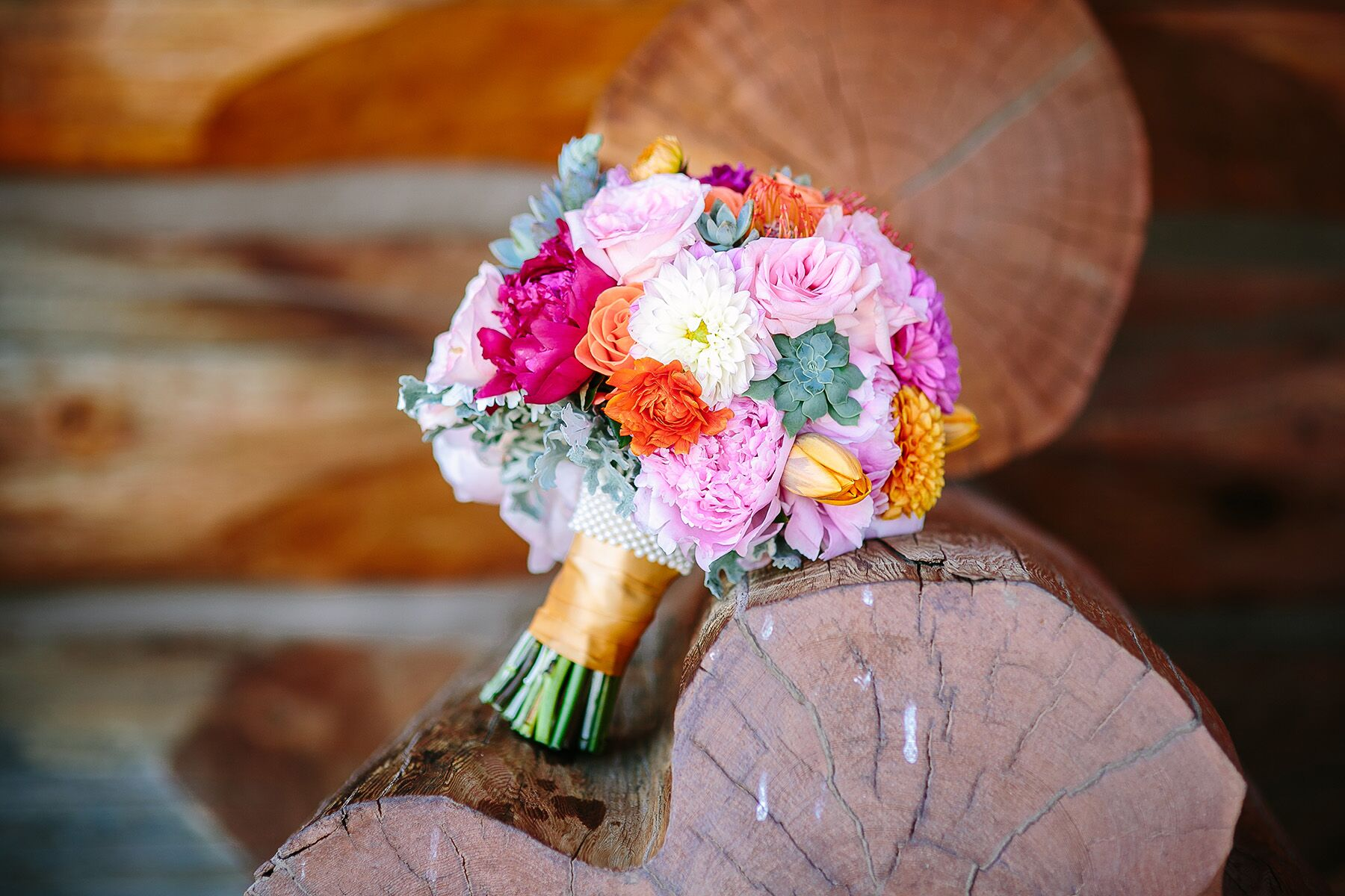 A Bright Pink And Orange Rose And Peony Bouquet